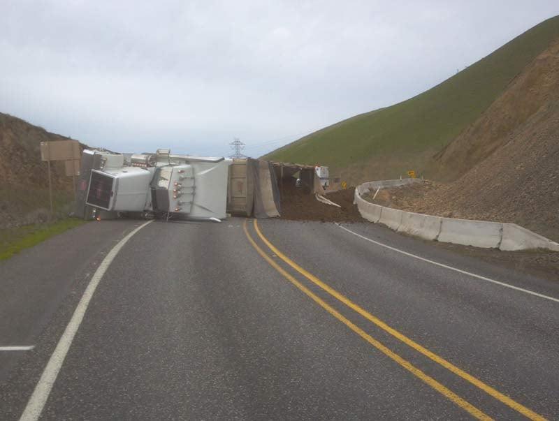 An overturned semi spilled manure across SR-14 in Klickitat County on Wednesday morning. (Photo: WSDOT)