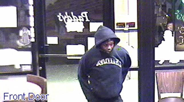 Surveillance image of armed robbery suspect at Paddy's in NE Portland. (Photos: Portland Police Bureau)