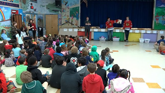 Members of the Portland Winterhawks visited several Portland schools Wednesday and read to students as part of Read Across America Day.