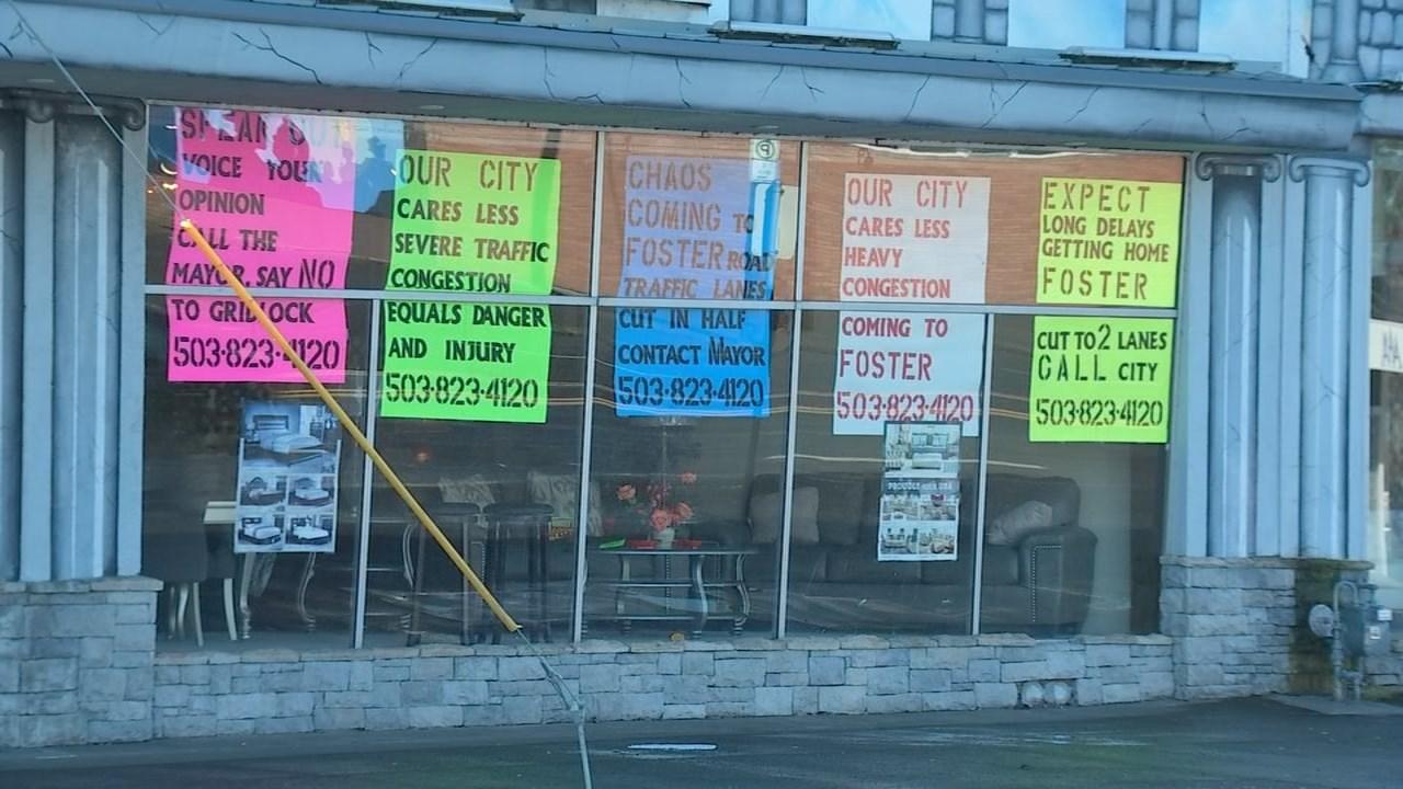 Signs posted in Jon Shleifer's business along Foster Road. (KPTV)