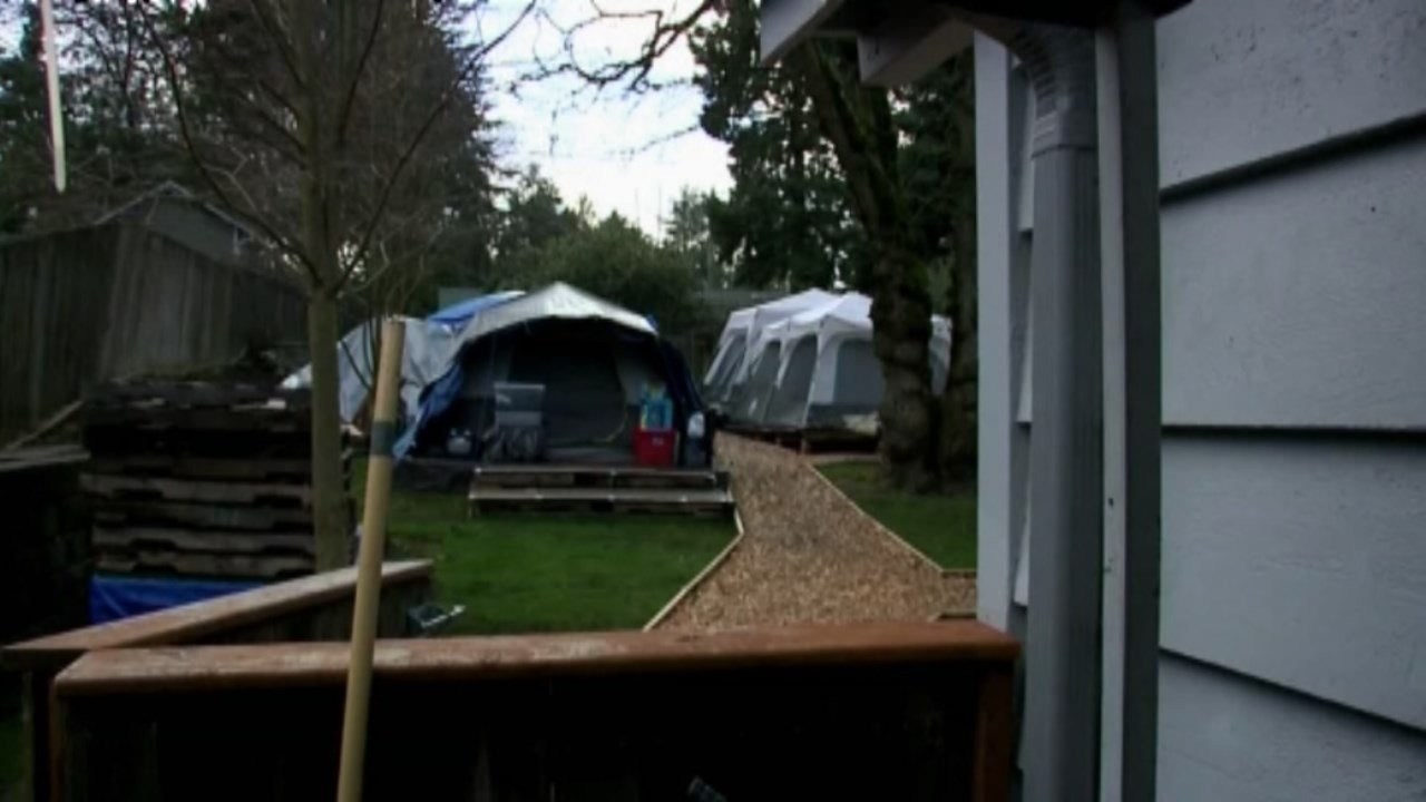 Seattle homeowners Kim and Brad Lancaster allowed a homeless camp to open in their backyard after the church housing the people was sold. (Q13 KCPQ)