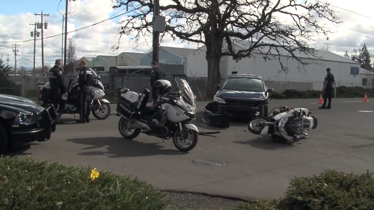 A Salem motorcycle officer was injured in a crash while responding to reports of a pedestrian hit by a train.
