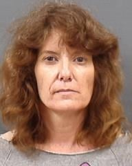 Jill Michelle Auxier, 50, faces charges of meth possession and endangering the welfare of a minor. (Yamhill County Jail)