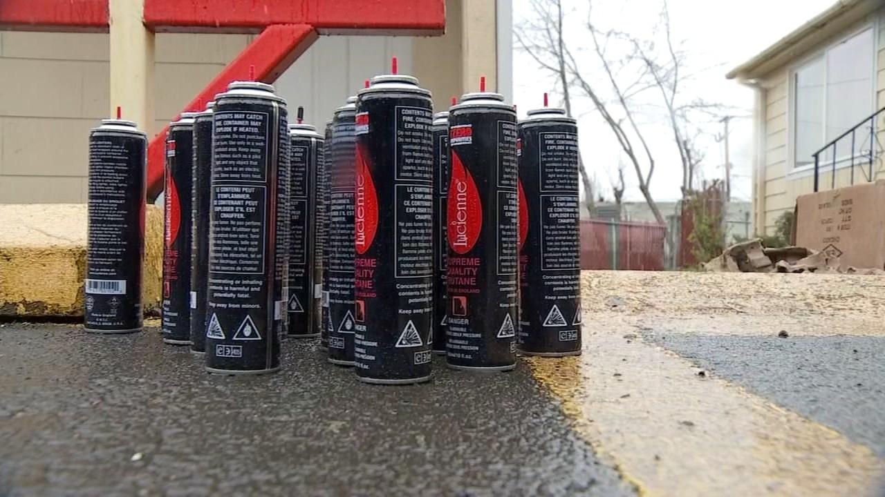 Cans of butane outside the home in NE Portland (KPTV)