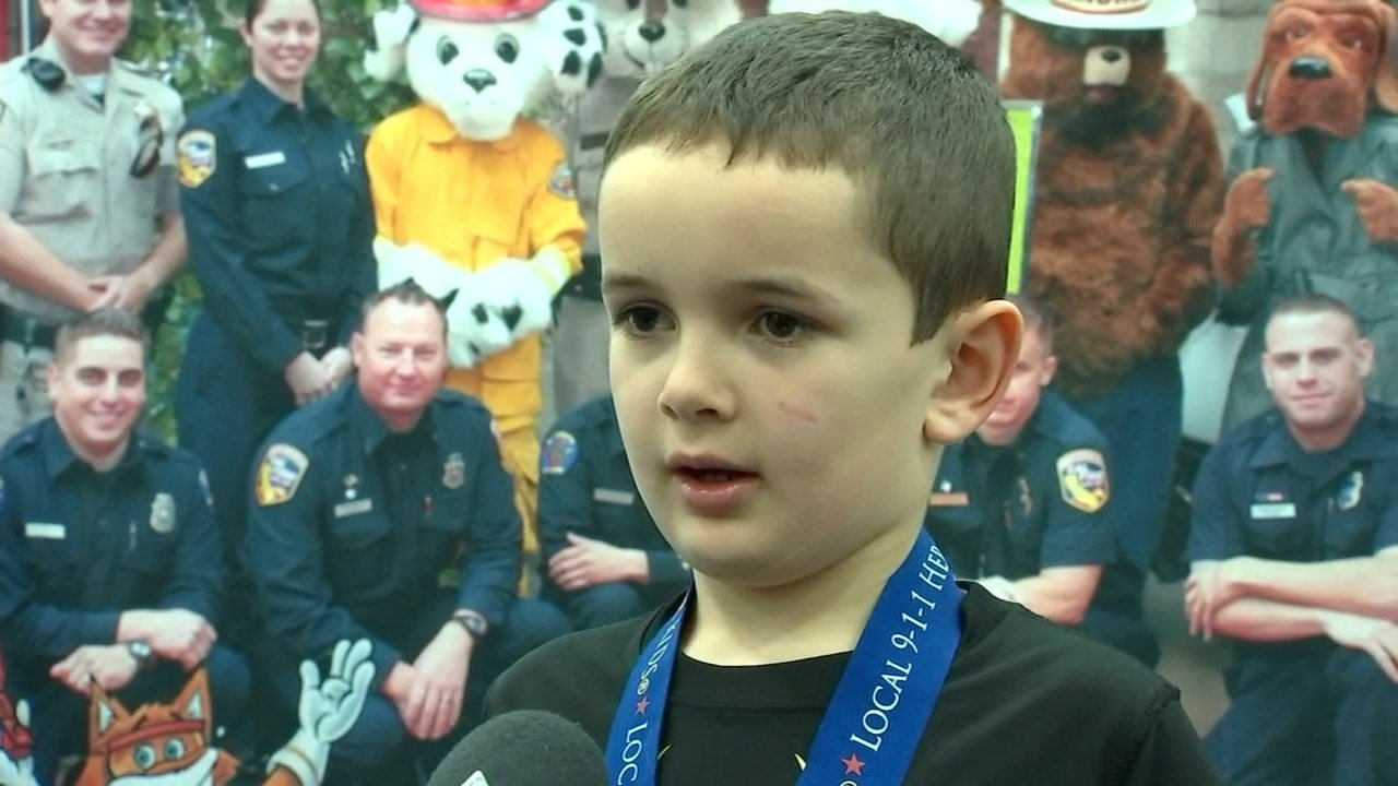 Devin Duke, 7, was awarded a 911 Hero medal at the 2016 APCO Western Regional Conference in Portland for his efforts to try and save his late father. (KPTV)