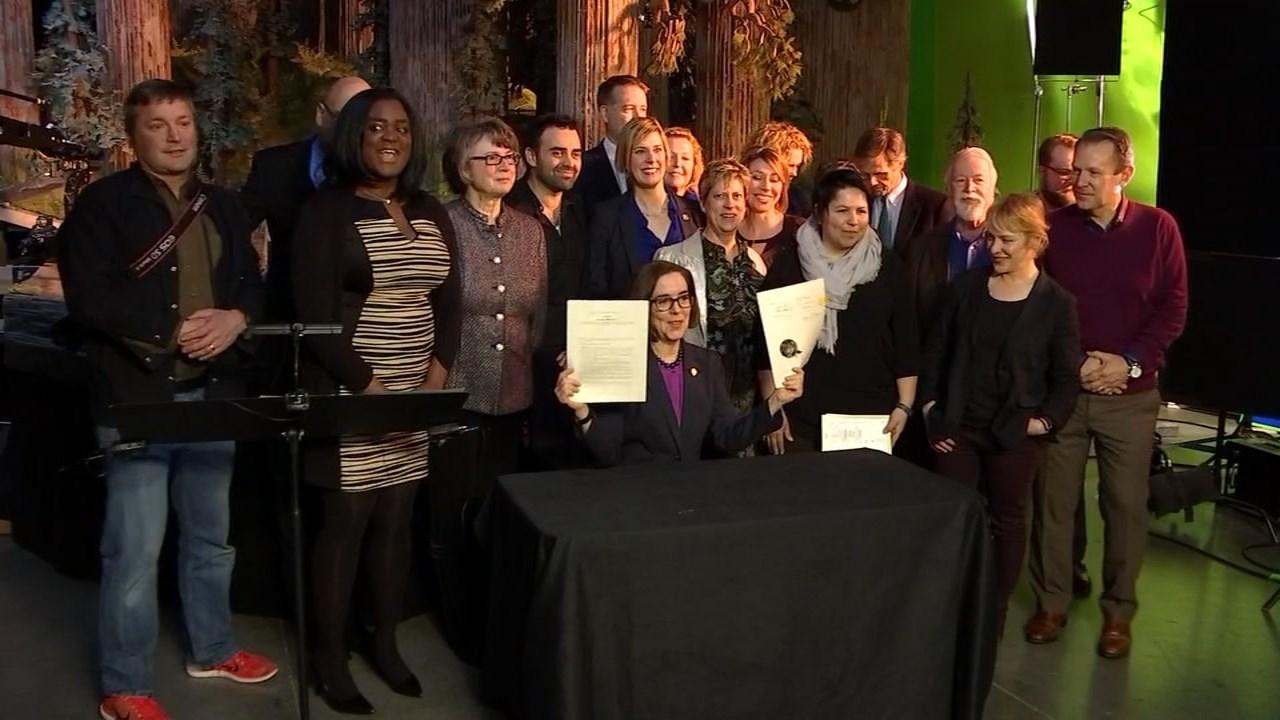 Governor Brown signed Senate Bill 1507 at Laika in Hillsboro on Thursday. (KPTV)