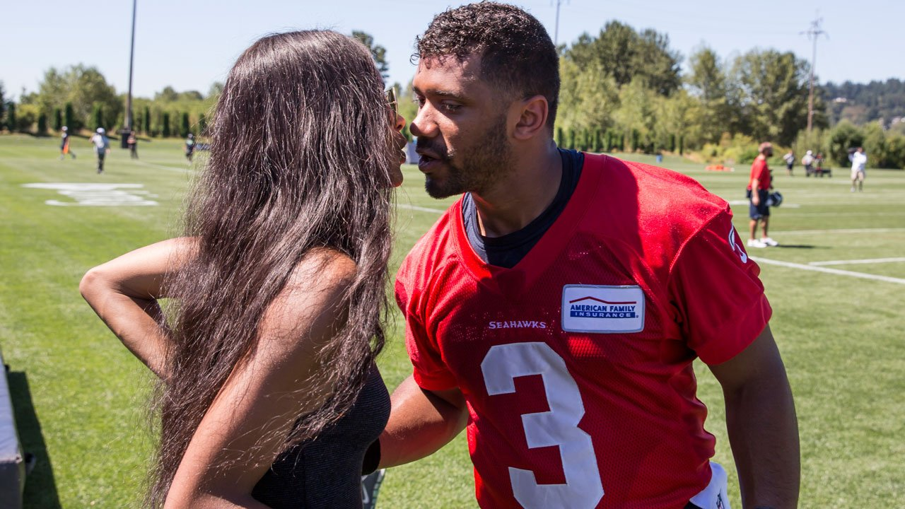 Seattle Seahawks quarterback Russell Wilson, right, kisses Ciara after an NFL football training camp on Friday, July 31, 2015, in Renton, Wash. (AP Photo/Stephen Brashear)