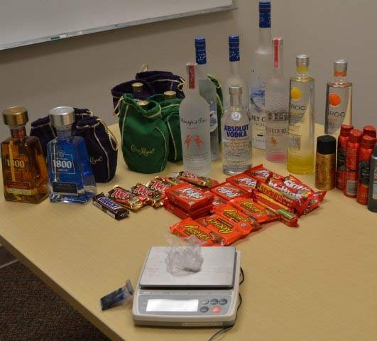 Photo of stolen alcohol, meth and other items recovered during arrest of two women at Battle Ground Albertsons store. (Photo: Battle Ground PD)