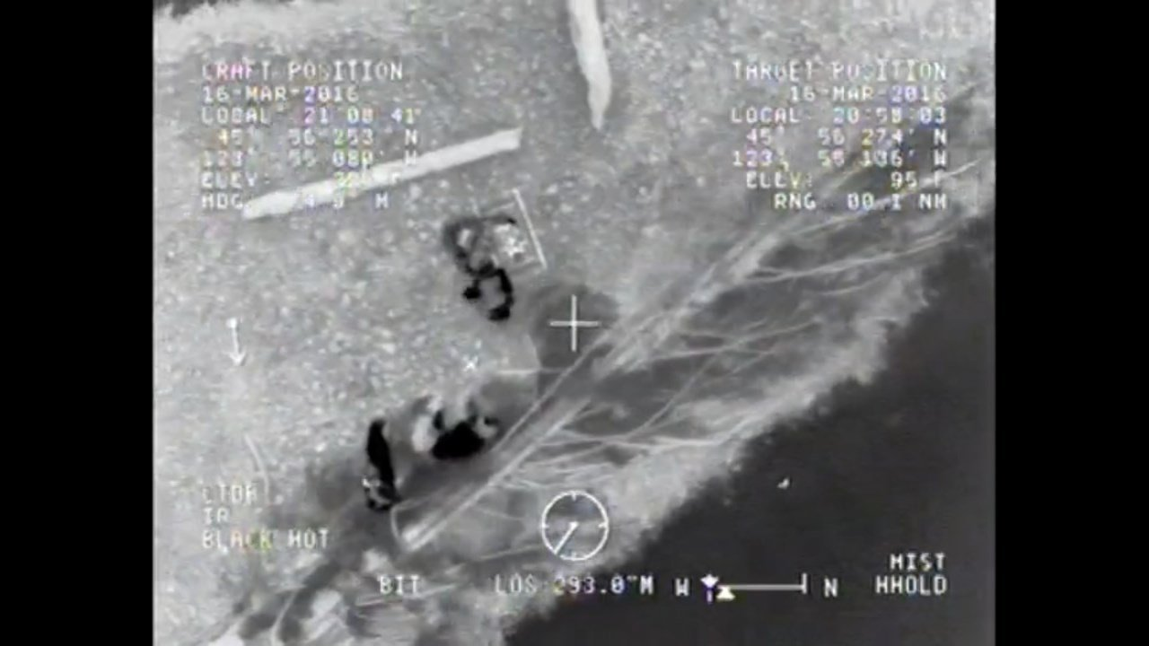 Image from Coast Guard MH-60 Jayhawk helicopter rescuing three stranded kayakers on the Oregon coast. (Image: USCG)