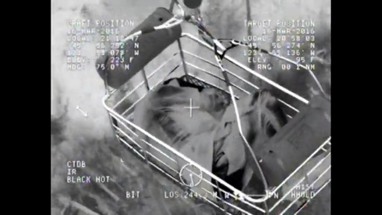 Image from Coast Guard MH-60 Jayhawk helicopter hoisting up a stranded kayaker on the Oregon coast. (Image: USCG)