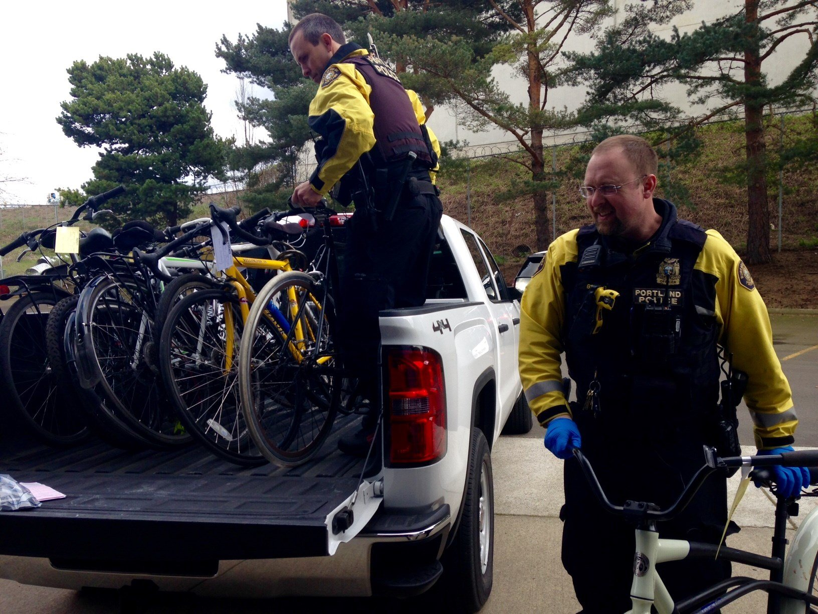 Officers Sanders and Bryant unloading stolen bikes into the police property room.
