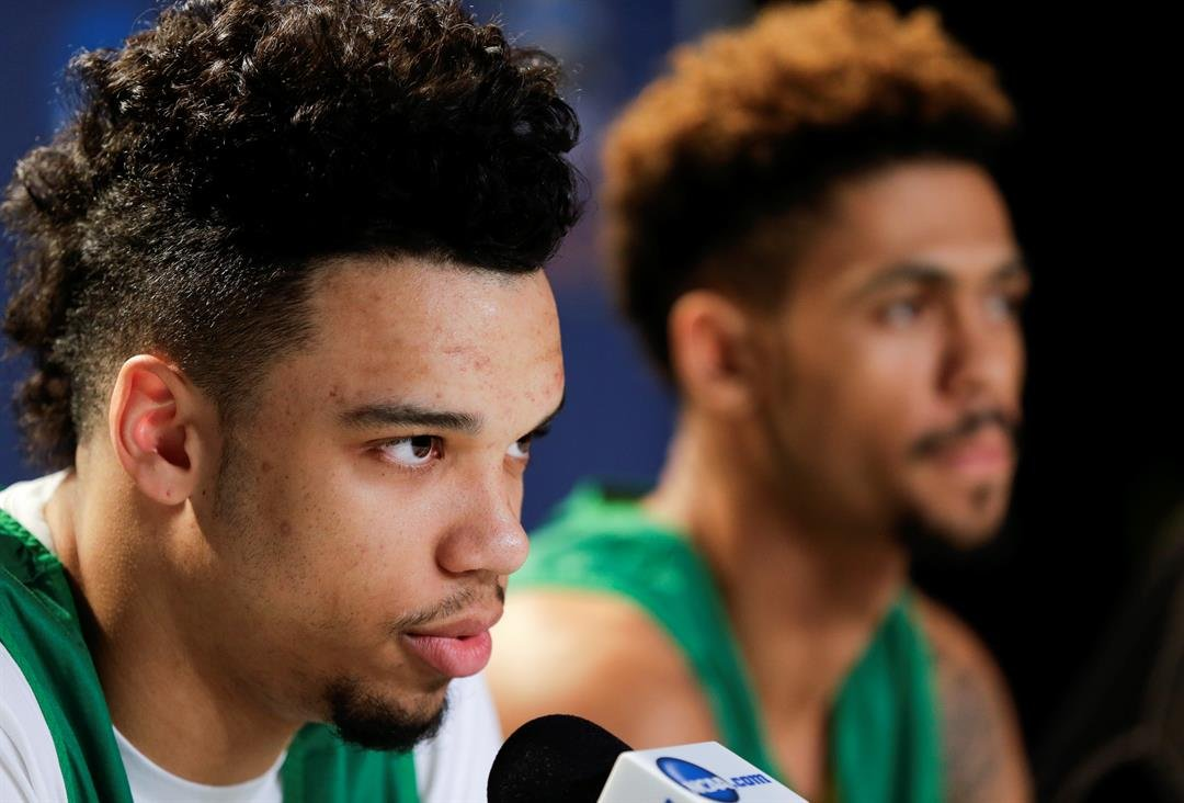 Oregon forward Dillon Brooks, left, speaks during a news conference alongside teammate guard Tyler Dorsey before an upcoming regional finals basketball game in the NCAA Tournament, Friday, March 25, 2016, in Anaheim, Calif. (AP Photo/Gregory Bull)