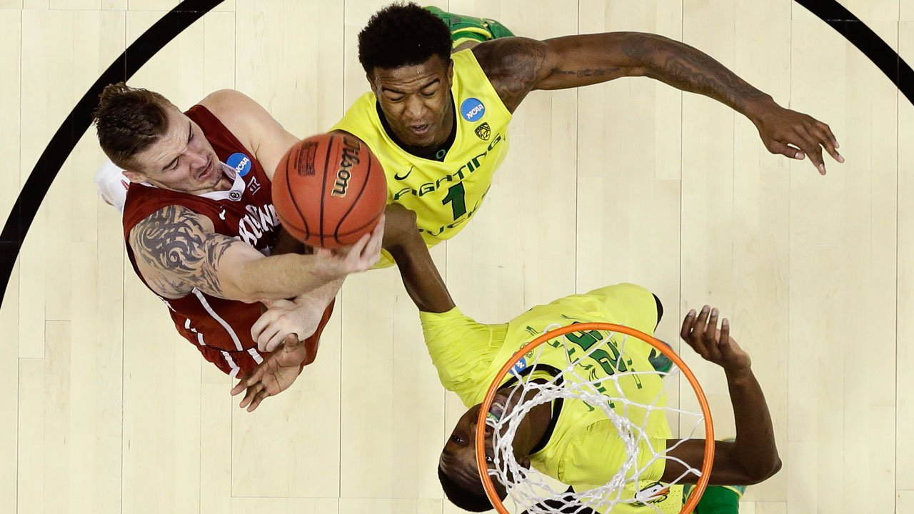 Oklahoma forward Ryan Spangler pulls a rebound away from Oregon forward Jordan Bell and forward Chris Boucher during the second half of the regional finals of the NCAA Tournament, Saturday, March 26, 2016, in Anaheim, Calif. (AP Photo/Gregory Bull)