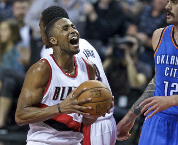 Portland Trail Blazers forward Maurice Harkless, left, reacts after scoring a basket against Oklahoma City Thunder center Steven Adams, right, during the first half of an NBA basketball game in Portland, Ore.(AP Photo/Craig Mitchelldyer)