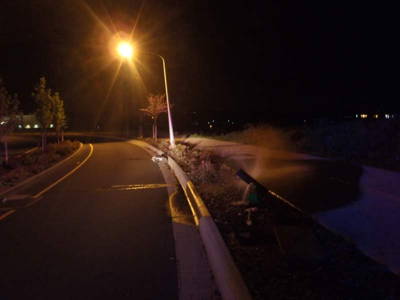 The hit-and-run driver also hit a sprinkler control box, causing water to spray from the broken pipes. (Photo: Sherwood PD)