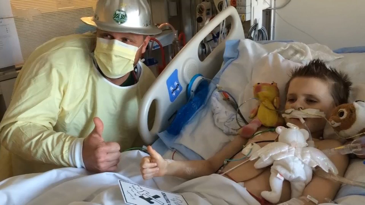 Landon was too sick to interact with Timber Joey when he previously visited the hospital. (Source: Jenn Breshears)