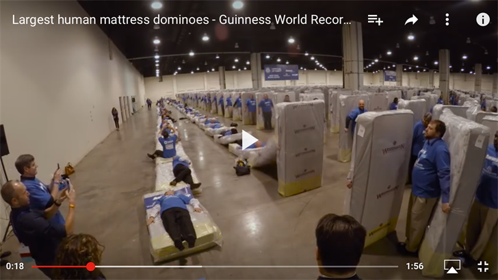 Employees at Aaron's Inc. broke the Guinness World Record for the longest human mattress domino chain in an attempt last month. (Guinness World Records/YouTube)