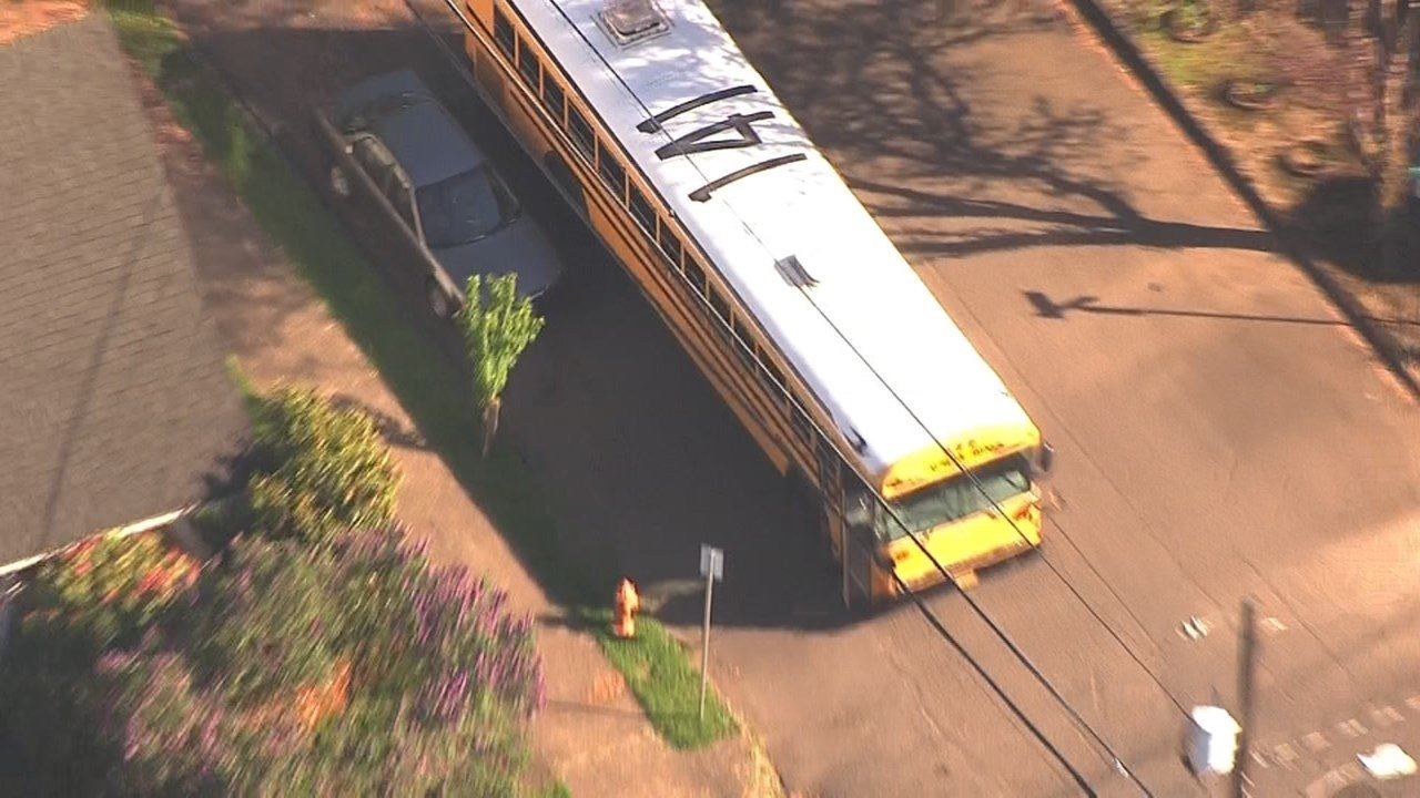 Crews from the Pregon City Police Department and Clackamas County Fire Department responded to reports of a school bus crash near Washington Street and 12th Street. Tuesday. (KPTV/Air 12)