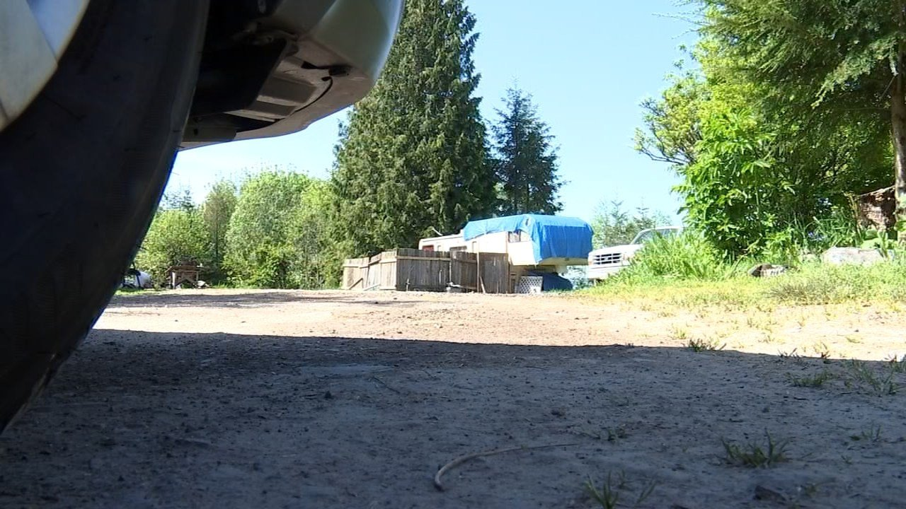 Neighbors claim the lack of a septic system has led people living in a cluster of trailers near Kelso to bathe in nearby streams and defecate in the woods. (KPTV)