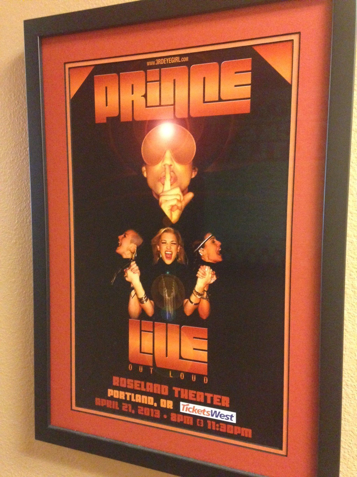 A poster from Prince's 2013 show, hanging at the Roseland Theater.