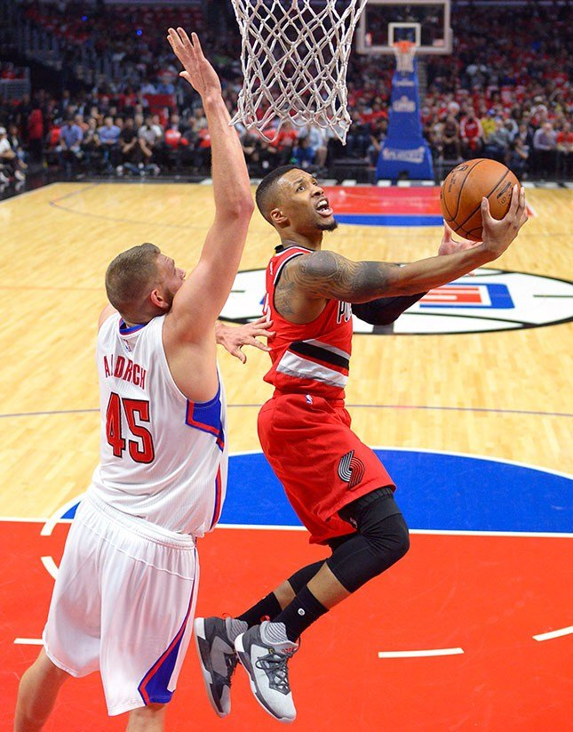 Portland Trail Blazers guard Damian Lillard, right, shoots as Los Angeles Clippers center Cole Aldrich defends during the first half in Game 5 of a first-round NBA basketball playoff series, Wednesday, April 27, 2016, in Los Angeles. (AP /Mark J. Terrill)