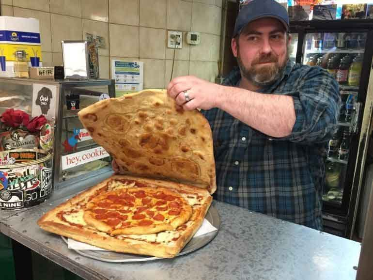 This pizza box pizza gives customers the option to eat the box and reduces cardboard waste. (Source: Rick Boone/WPIX)