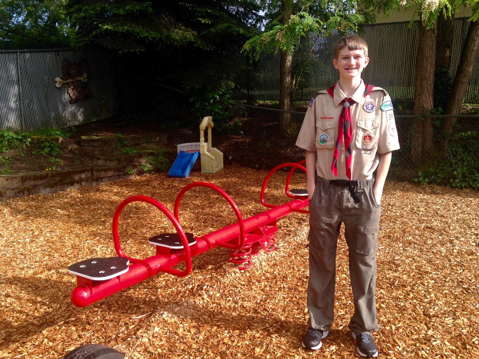 Brandon Miller in front of the new playground equipment at Share Homestead. (KPTV)