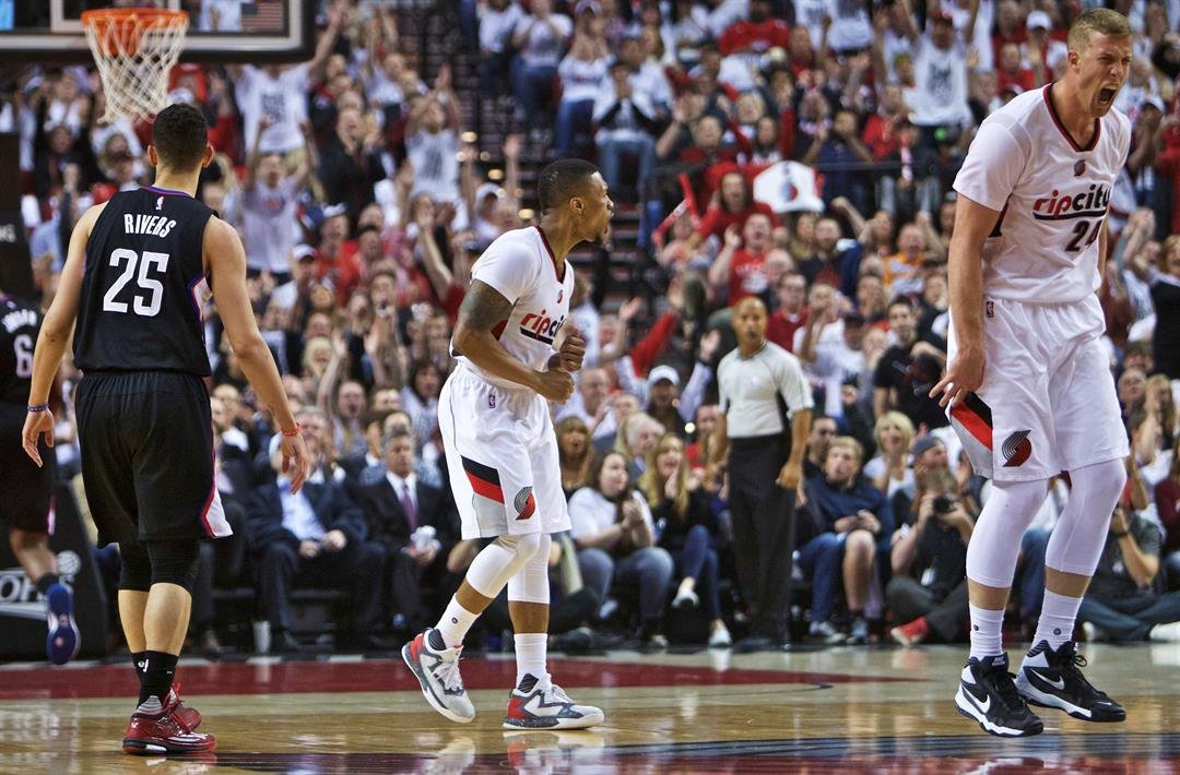 Blazers guard Damian Lillard and center Mason Plumlee react after Lillard made a 3-point basket over LA Clippers guard Austin Rivers in Game 6 of an NBA basketball 1st-round playoff series Friday in Portland, OR. (AP Photo/Craig Mitchelldyer)