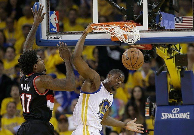 Golden State Warriors forward Harrison Barnes, right, dunks against Portland Trail Blazers center Ed Davis (17) during the first half in Game 2 of a second-round NBA basketball playoff series in Oakland, Calif., May 3, 2016. (AP Photo/Marcio Jose Sanchez)