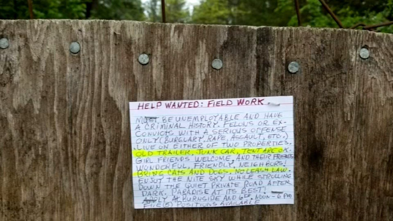 A help wanted sign soliciting convicted felons posted in the rural Skamania County neighborhood. (KPTV)