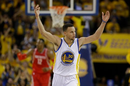 (AP Photo/Marcio Jose Sanchez). Golden State Warriors' Stephen Curry (30) celebrates after scoring against the Houston Rockets during the first half in Game 1 of a first-round NBA basketball playoff series Saturday, April 16, 2016, in Oakland, Calif.  Rea