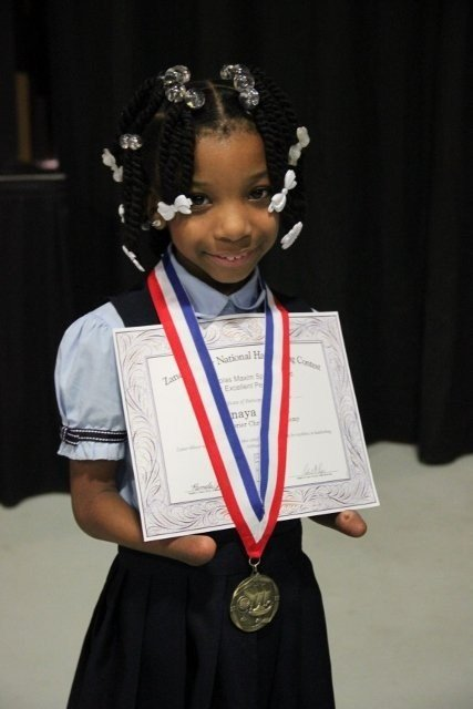 First grader Anaya Ellick received the Nicholas Maxim Special Award for Excellence in Manuscript Penmanship at her school in Chesapeake, Virginia, an impressive achievement for someone born without hands. (CNN/WTKR)