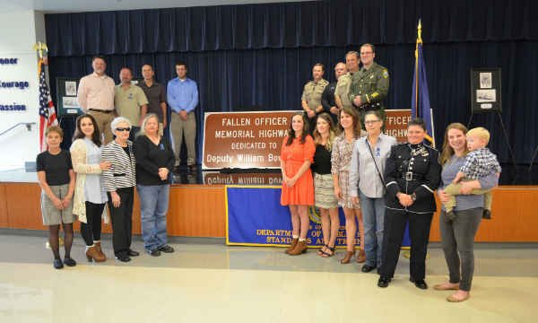 Bowman's family with the Memorial Highway Sign (Courtesy: Clackamas County Sheriff's Office)