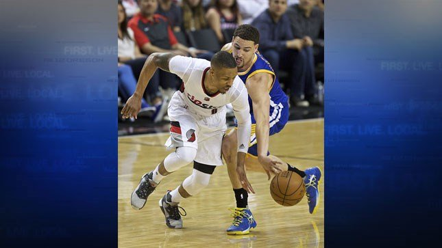 Golden State Warriors guard Klay Thompson knocks the ball away from Portland Trail Blazers guard Damian Lillard during the second half of Game 4 of an NBA basketball second-round playoff series, May 9, 2016, in Portland, Ore. (AP Photo/Craig Mitchelldyer)