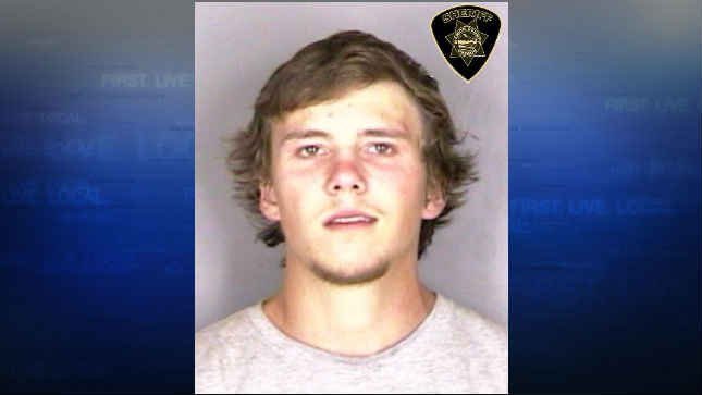 Colton McElroy, jail booking photo (KPTV)