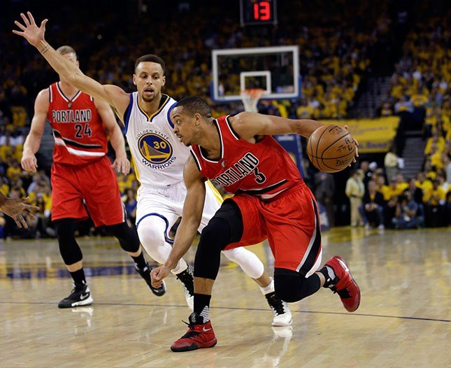 Portland Trail Blazers' C.J. McCollum (3) dribbles past Golden State Warriors' Stephen Curry (30) during the first half in Game 5 of a second-round NBA basketball playoff series Wednesday, May 11, 2016, in Oakland, Calif. (AP Photo/Marcio Jose Sanchez)