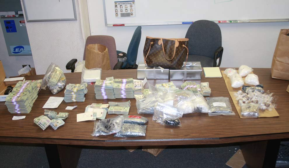Police seized 14 pounds of meth, 10 pounds of heroin, 2 pounds of cocaine and $446,000 as part of the operation. (Photo: Salem PD)