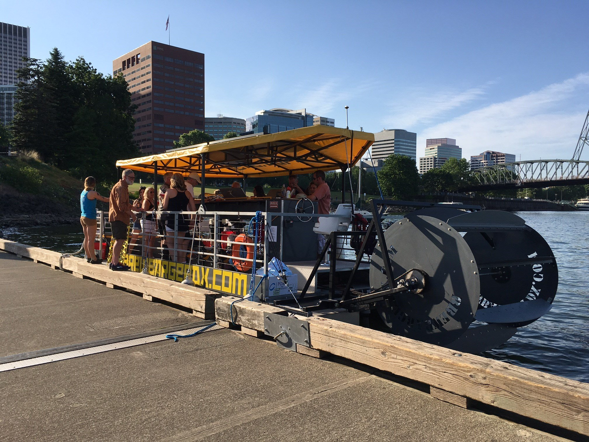 People on the Beer Barge in downtown Portland Friday.