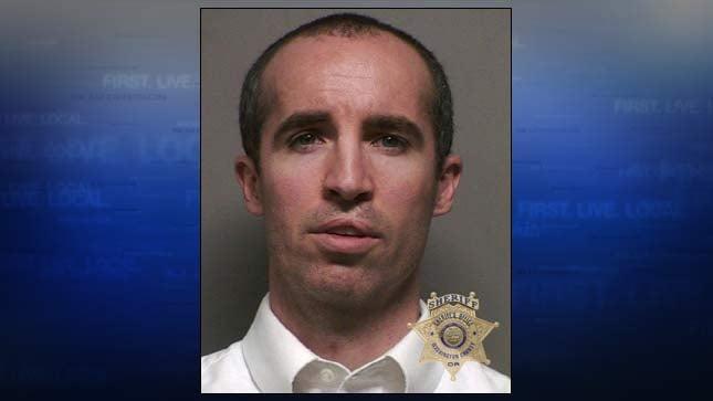 Alex Woolner, jail booking photo
