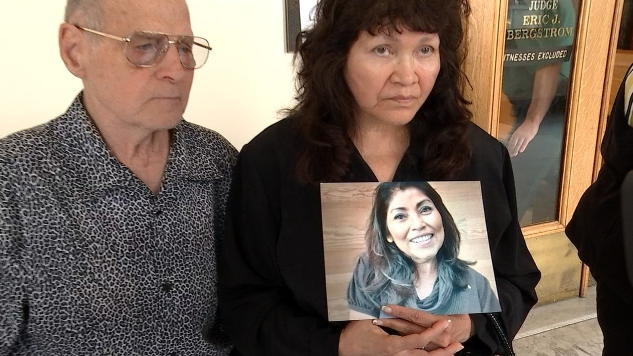 Elizabeth Kemble's mother holding a photo of her daughter outside the courtroom Tuesday. (KPTV)