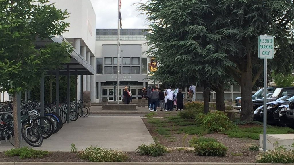 Forest Grove HS students gathered outside the school Thursday in protest of a banner hung in the school earlier in the week advocating building a wall, referencing a topic from the Donald Trump campaign. (KPTV)