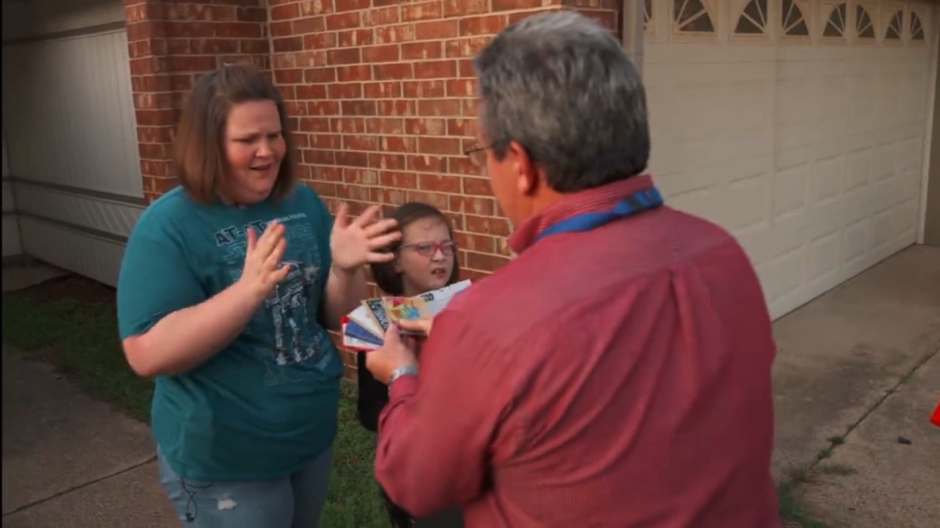 Kohl's awarded Candace Payne and her family with more Chewbacca masks and gift cards to show their appreciation of her viral video. (Photo: CNN)