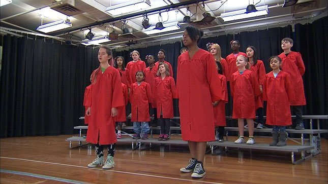 Choir students from Faubion School in north Portland rehearse for their performance in Hawaii this weekend. (KPTV)