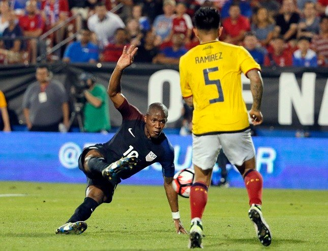 U.S. midfielder Darlington Nagbe takes a shot and scores in front of Ecuador's Christian Ramirez (5) during the second half of an exhibition soccer match, Wednesday, May 25, 2016, in Frisco, Texas. The United States won 1-0. (AP Photo/Tony Gutierrez)
