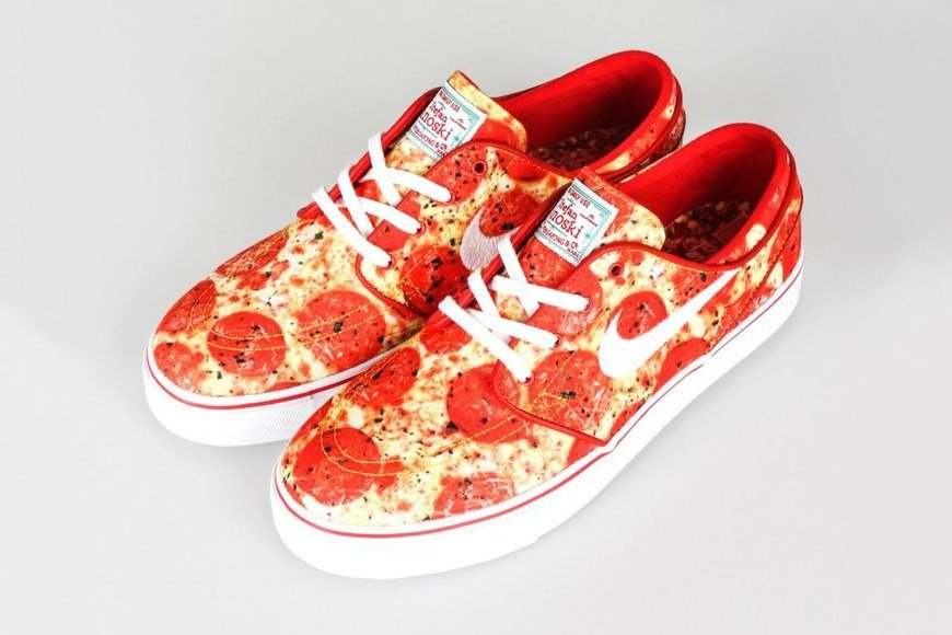 Pizza themed Nikes feature red marinara sauce inspired soles and a cheesy exterior topped with pepperoni.