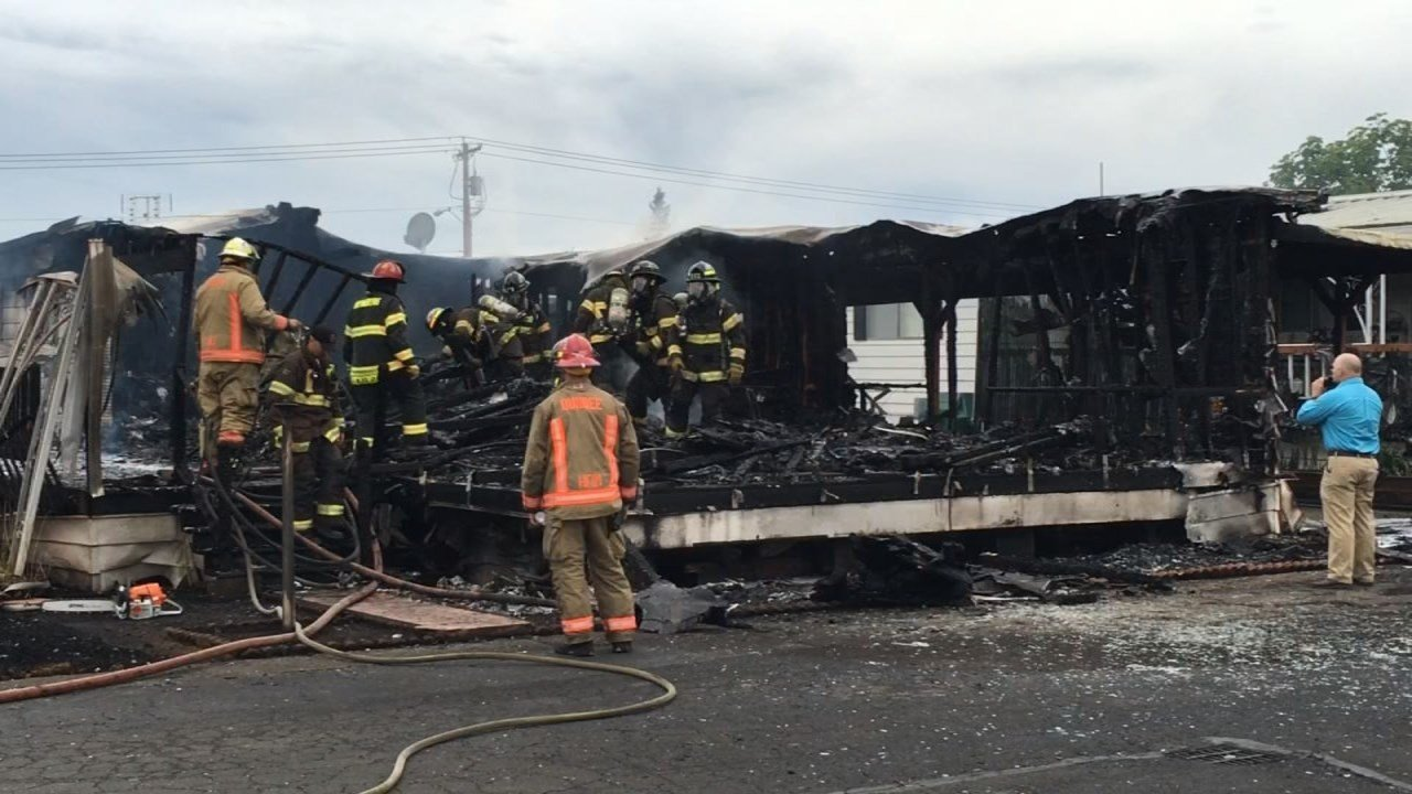 Firefighters at the scene of a deadly fire in Newberg on Wednesday. (Source: KPTV)