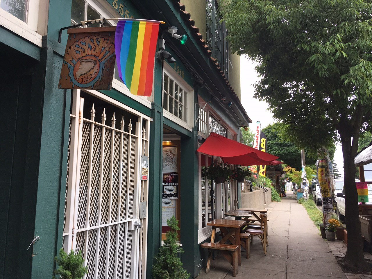 Some of the rainbow flags at businesses on N. Mississippi Monday.
