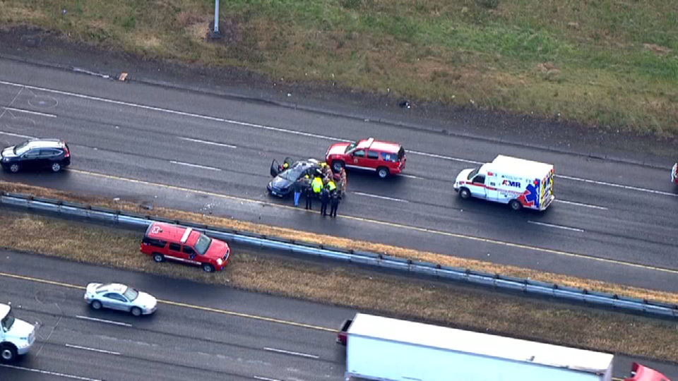 Air 12 over scene on I-205