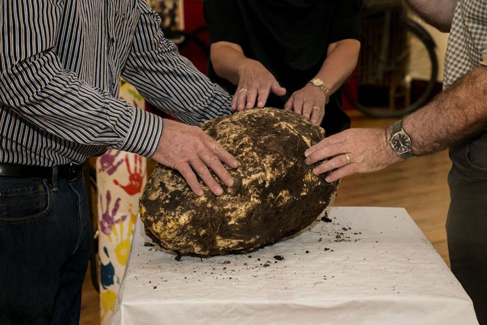 Buried 12 feet, Jack Conaway found a massive 22 pound (10 kilogram) chunk of butter estimated to be 2,000 years old. (Photo: Cavan County Museum)