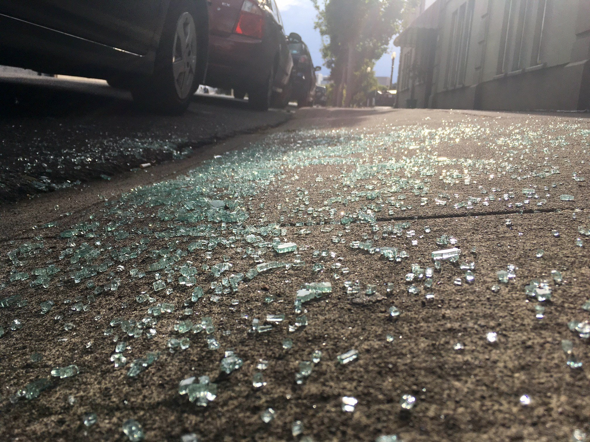 Shattered glass on the ground from a car break-in at SE 6th & Yamhill. (KPTV)